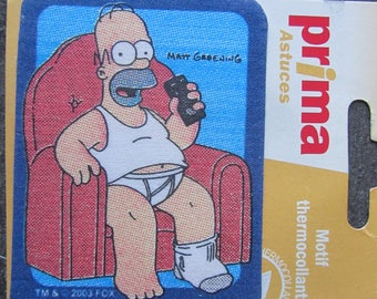 "Fusible patterns representing ""Homer in his chair"""