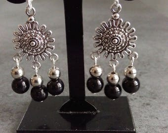 pair of black and Silver earrings