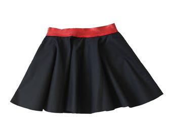 Who turns black and red glitter skirt