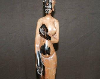 Woman sculpture Amazon topless wooden African craft. Height 39 cm