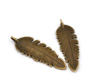 2 antique bronze feather pendants