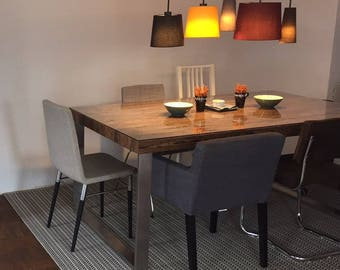 Reclaimed wood dining table with stainless steel - frame