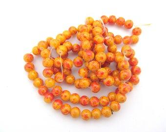 Set of 10 orange red round glass beads