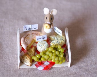 Mouse cold porcelain on a cheese tray.
