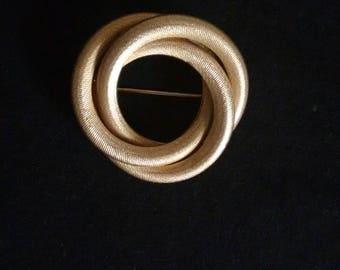 Sarah Coventry swirl brooch