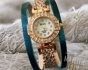Gold ladies watch size. S summer 2018. round blue pink gold cuff bracelet. oil and gold