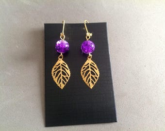 Pair of gold dangle earrings and violete