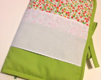 Health book has cross-stitch fabric green flower pattern