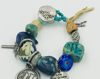 Neverland Talisman Bracelet with pewter charms, clay beads, and silver tone button closure