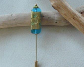 """Blue lagoon"" gold tone pin"