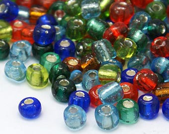 Seed beads of glass, silver, multicolored.