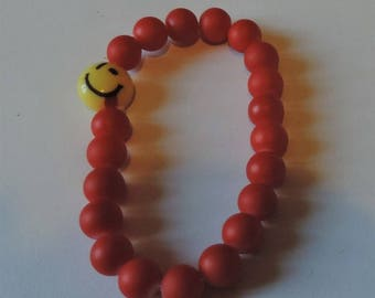 Stretch Bracelet with red glass beads and emoticon