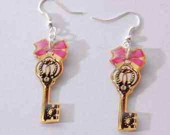 Golden key earrings, pink bow
