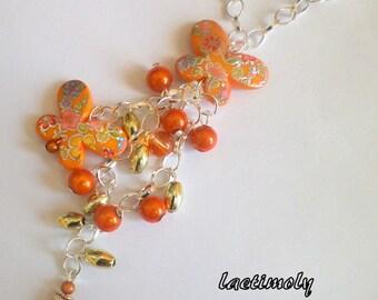 long cascade of orange beads and butterflies