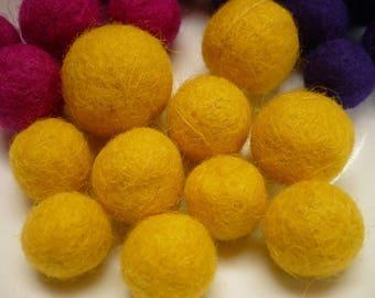 set of ten yellow felted wool beads