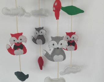 Mobile in felt and Driftwood with red and gray foxes
