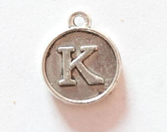 Silver metal charm, letter K, about 15 * 12 * 2 mm