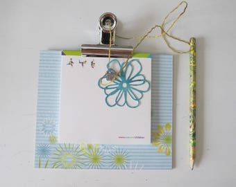 Notebook with blue and green pencil