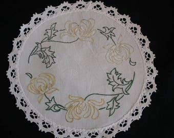 Doily round young flowers