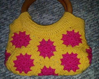 Crocheted granny square lined purse with wooden handles