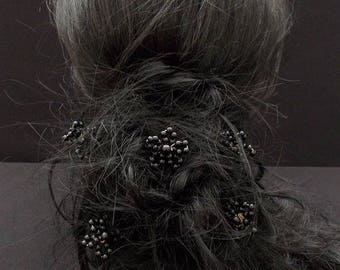 A black flower hair pins