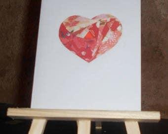 Red heart in iris folding card