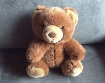 Plush brown bear heating pad