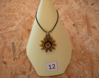 beige and black flower pendant