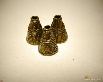 3 bronze Cone beads