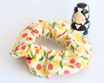 Fabric scrunchies patterned yellow and Red cherries