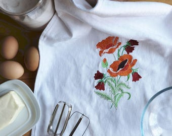 Dish towel with floral embroidery by machine
