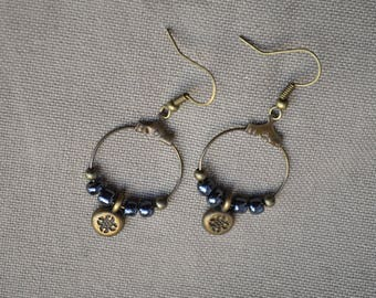 Earrings in shades of grey metallic and bronze rings