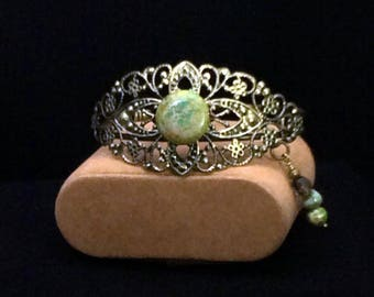 One-size, antiqued bronze metal filigree bangle bracelet with Jasper focal stone. Beautiful compliment to any outfit!