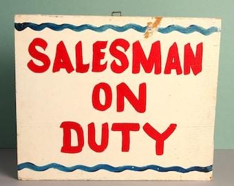 Vintage Handpainted Wooden Salesman On Duty Sign