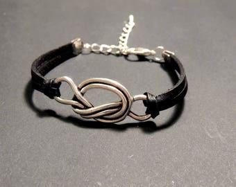 Black leather, metal knot bracelet