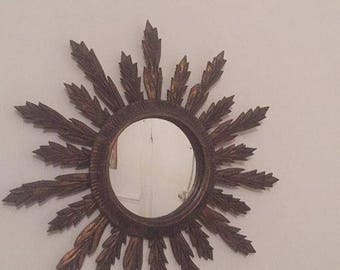 Beautiful and sought after Sun gilt wood mirror. late 19th.