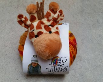 this giraffe, a ball top ball = a hat