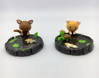 Kitten and Koi pond