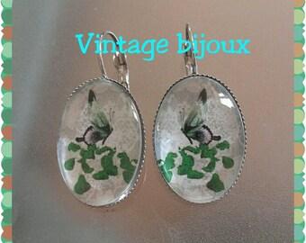 Pair of silver butterfly earrings retro