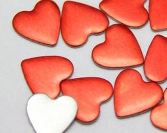 Bag of 5 fusible studs 10mm red heart