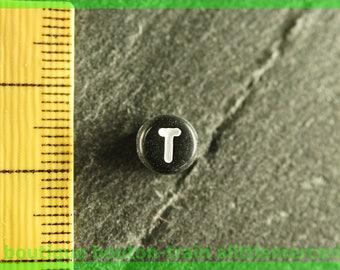 t plastic Pearl round black and white alphabet