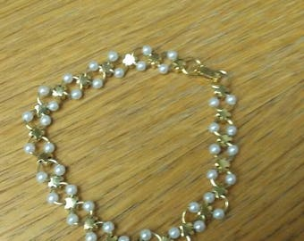costume jewlery bracelet clear gems and pearl-like beads