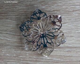 shiny metal filigree flower