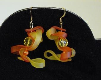 RUBBER EARRINGS YELLOW AND ORANGE WITH GLASS BEAD