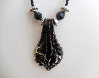 language in black and silver murano glass