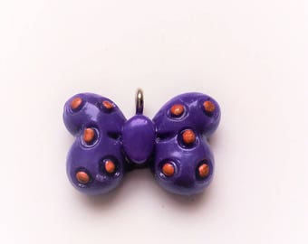 x 1 Purple bow charm and gold dots