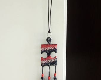 Necklace puzzle cardboard, red, black and silver tassel