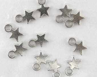 40 charms star pattern in silvery metal aged bc075