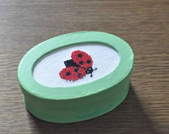 Green box with Ladybug cross stitch