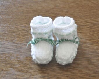 White and green slippers